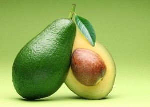 Avocado isolated on a green background.