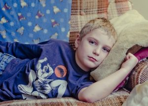 Boy sofa tired unwell_childhood cancers_oncology news australia