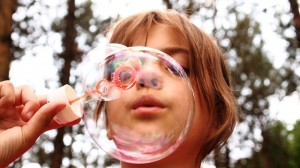 Girl blowing bubbles_child childhood cancers_oncology news australia