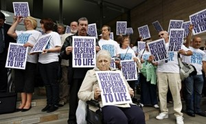 Protesters in London call for life-saving cancer drugs to be made available on the NHS in 2008.