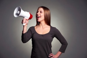Woman with loudspeaker_advocacy concept_oncology news australia