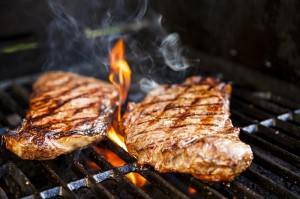 Steaks on barbecue