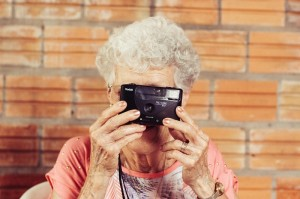 camera meaning older woman viewing life through a lense_oncology news australia