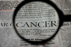 cancer-news-concept_newspaper magnifing glass_oncology news australia