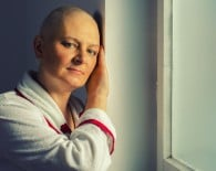 Bald woman suffering from cancer