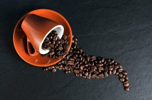coffee cup and beans slate background_oncology news australia