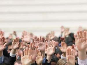 crowd of hands_patient selection concept_oncology news australia_800x500