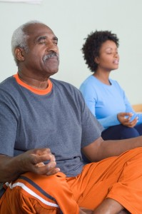 man and woman yoga relaxation meditation_oncology news australia
