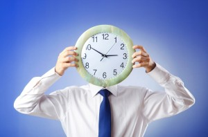 man holding clock_time concept_oncology news australia