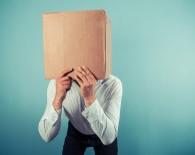 Man with cardboard box on his head