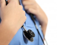 Close up of a nurse hands with stethoscope