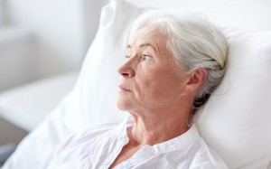 older woman bed hospital bed thoughtful reflective portrait_oncology news australia