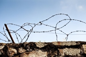 Stone wall with barbed wire