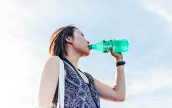 woman drinking soda sweetened fizzy drink coke sprite breast cancer risk oncology news australia
