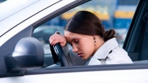 woman driving car_unwell tired therapy_oncology news australia