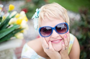 woman happy smiling optimistic outdoors sunglasses_oncology news australia