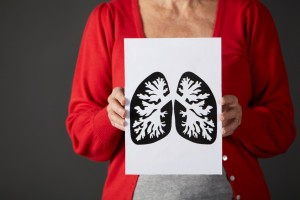 woman holding drawing of lung_lung cancer concept_oncology news australia
