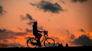 woman outdoor health wellbeing cycle sunset_oncology news australia