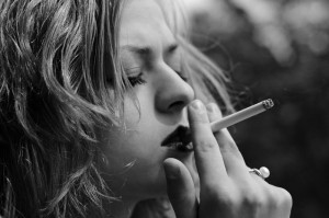 woman smoking bw