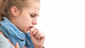 woman young adult coughing lung pulmonary symptoms-oncology news australia