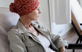 woman with cancer looking away_oncology news australia