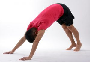 yoga downward dog man prostate cancer_oncology news australia