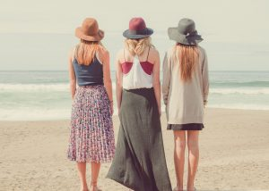 young australian women back portrait group beach hats_oncology news australia